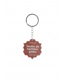 Brown wooden keychain with a Song and Dance Celebration logo